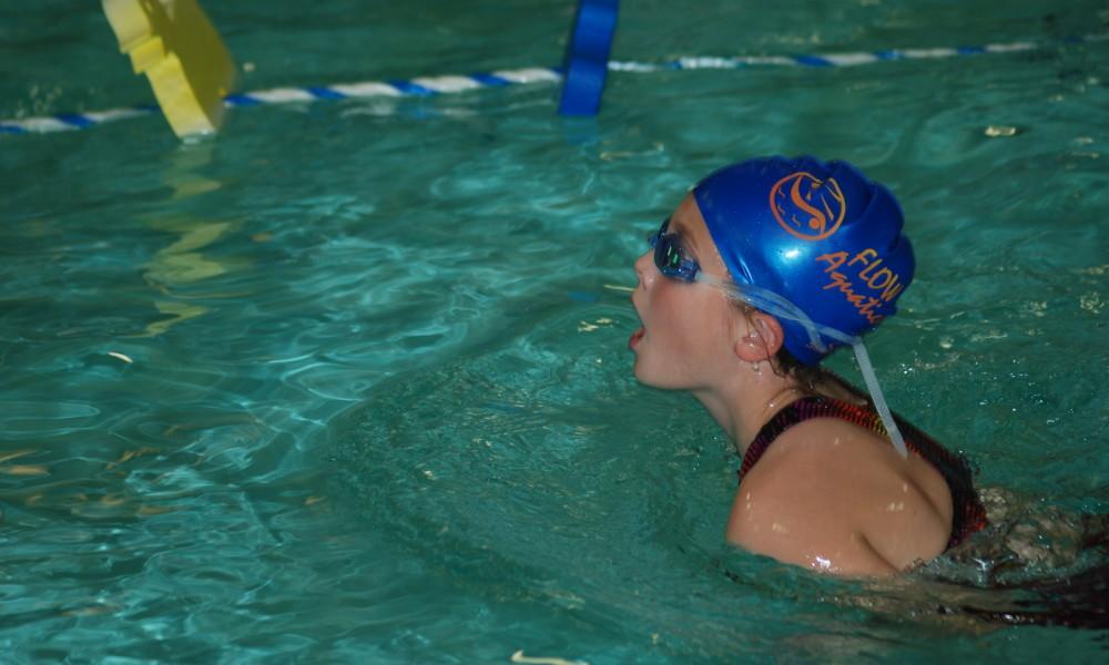 girl-in-a-blue-swim-swimming-in-a-pool